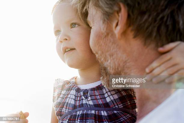 Close up of female toddler and father face to face