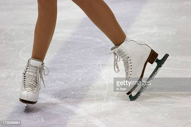 close up of figure skaters feet in skates on ice - ice skate stock pictures, royalty-free photos & images