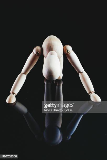 Close Up Of Figurine Against Black Background