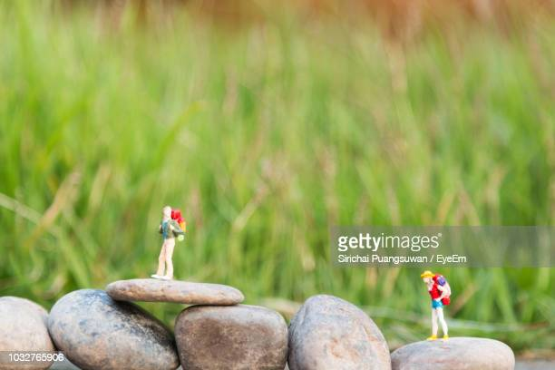 close up of figurines on rock - human representation stock pictures, royalty-free photos & images