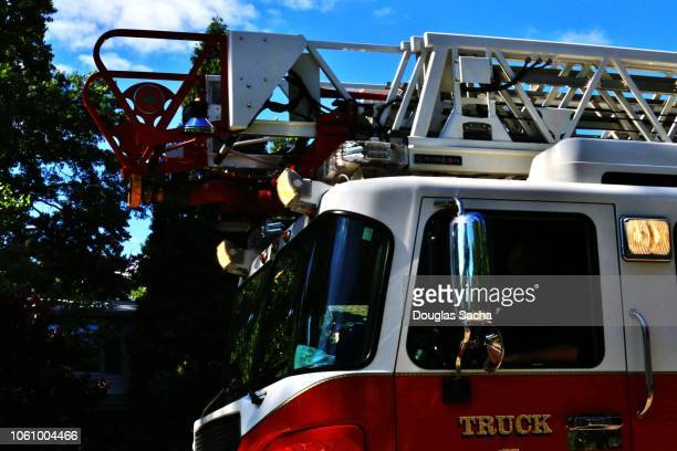 Close up of fire truck with overhead ladder