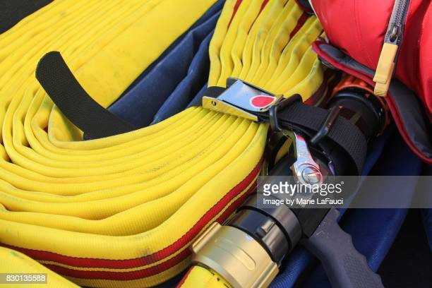 Close up of firefighter's water hose