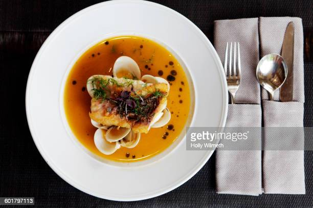 Close up of fish and soup dish