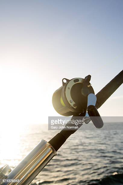 close up of fishing rod on yacht, early morning