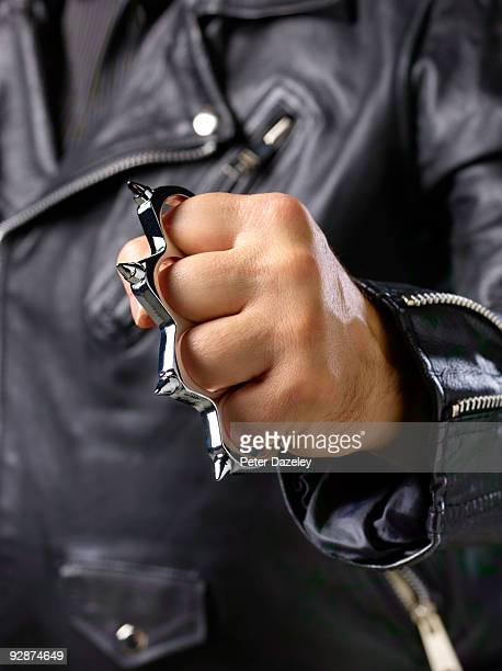 Close up of fist with knuckle duster.