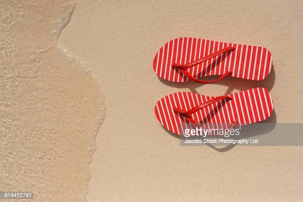 close up of flip flops on beach - open toe stock pictures, royalty-free photos & images