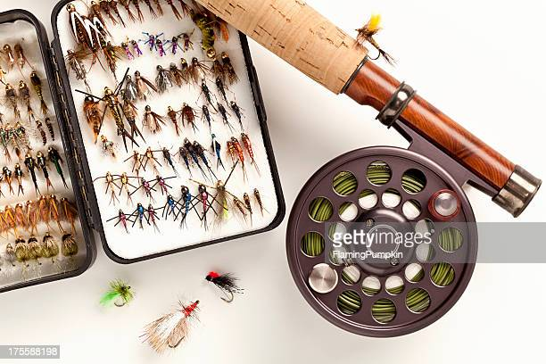 Close up of Fly-Fishing Rod and Lures on White.