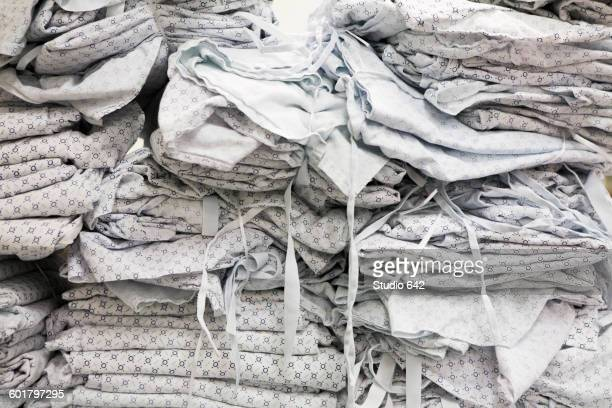 Close up of folded hospital gowns