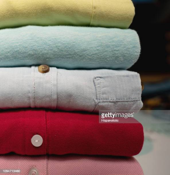 close up of folded shirts - dry cleaned stock pictures, royalty-free photos & images