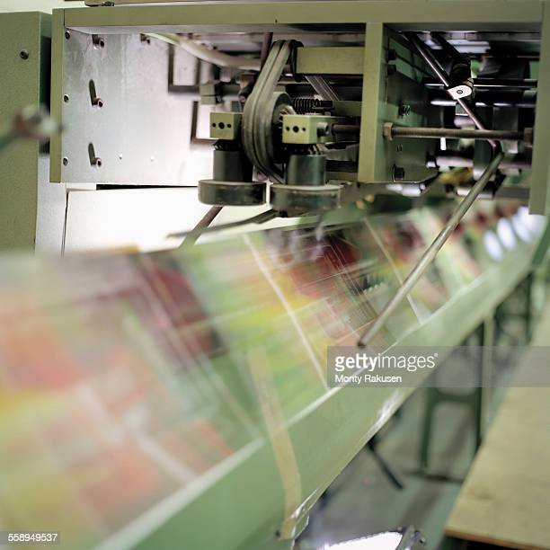 Close up of folding machine in printworks