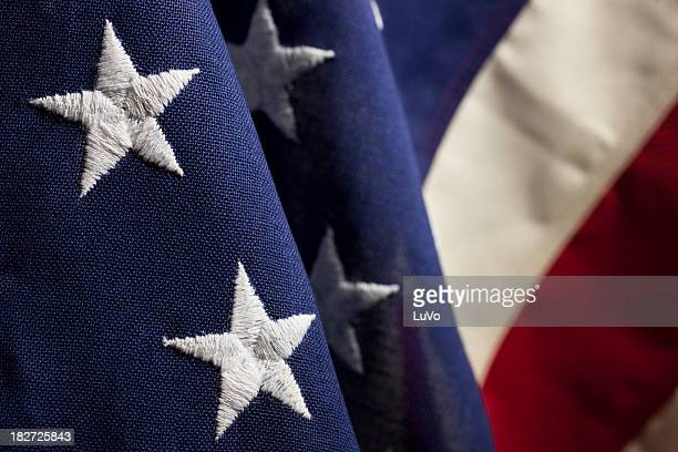 close up of folds and stitching in american flag - stars and stripes stock pictures, royalty-free photos & images