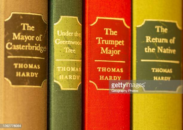 Close up of Folio Society hardback books by Thomas Hardy focus on gilt spine title 'The Trumpet Major''.