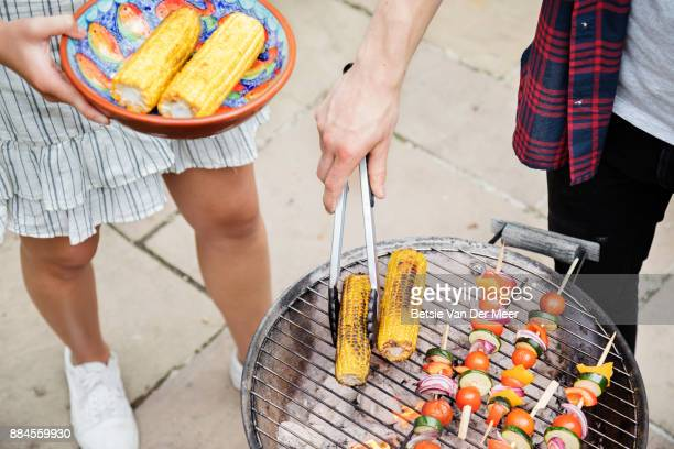 Close up of food being prepared on barbecue.
