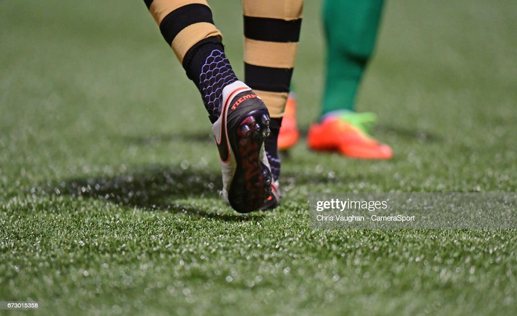 A close up of football boots on the artificial playing surface at Maidstone United's Gallagher Stadium during the Vanarama National League match between Maidstone United and Lincoln City at Gallagher Stadium on April 25, 2017 in Maidstone, England.
