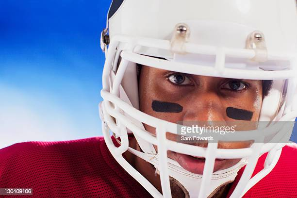 close up of football player wearing helmet - safety american football player stock pictures, royalty-free photos & images
