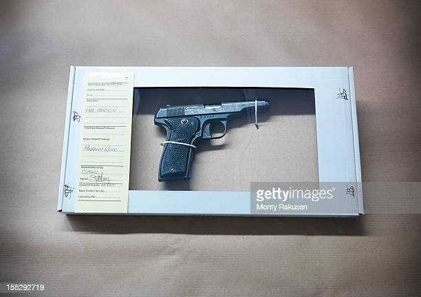 close up of forensic science evidence box containing gun from crime scene - 証拠 ストックフォトと画像