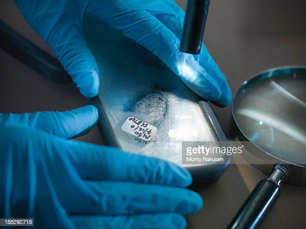 Close up of forensic scientist examining finger print in laboratory