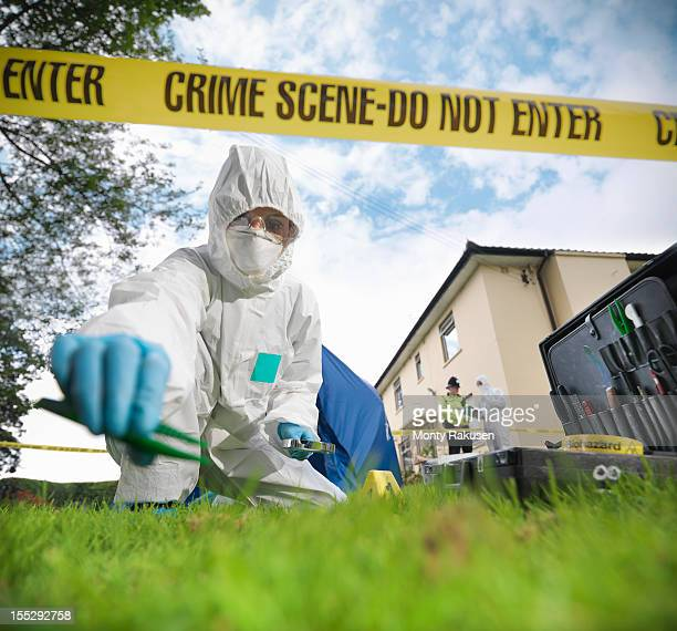 close up of forensic scientist taking sample at crime scene, surface level view - forense fotografías e imágenes de stock