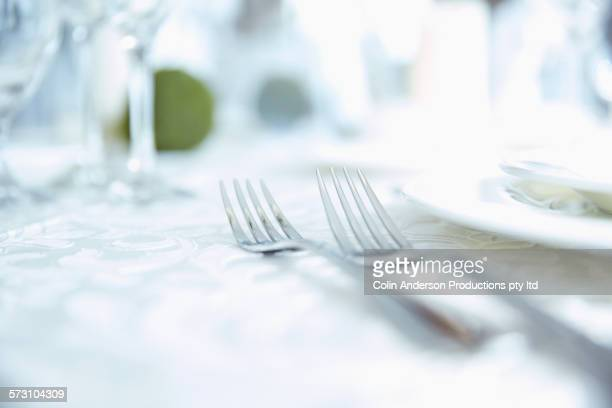 Close up of forks in place setting on table