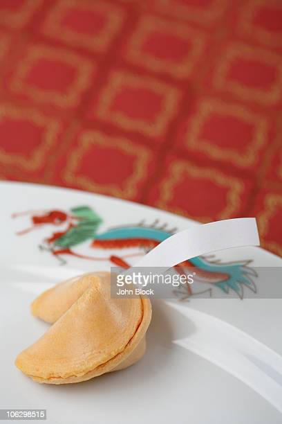 Close up of fortune cookie on plate