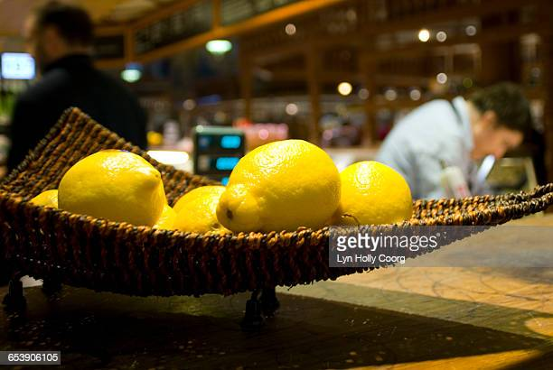 close up of fresh lemons in bar with bar staff - lyn holly coorg stock pictures, royalty-free photos & images