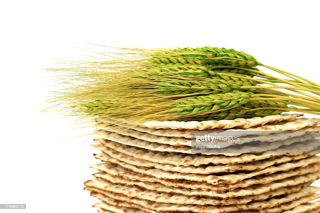 Close up of fresh wheat laying atop a pile of Matzoh : Stock Photo