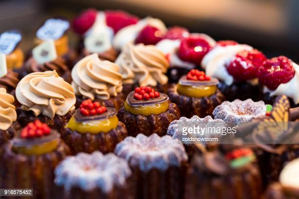 close up of freshly baked cakes and cupcakes in a row at food market - sweet food stock pictures, royalty-free photos & images