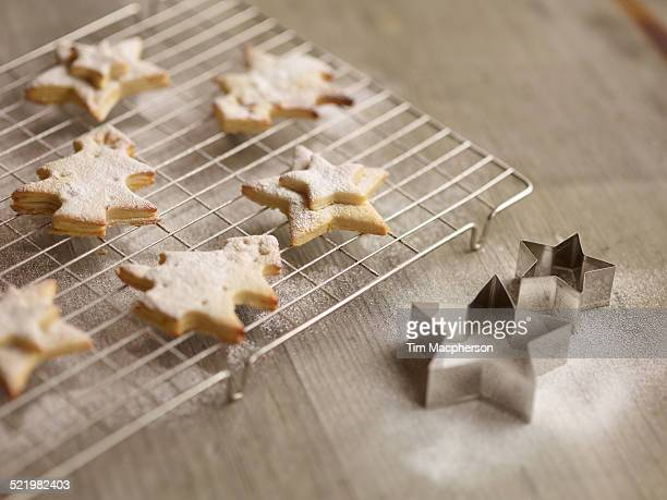 Close up of freshly baked christmas biscuits on cooling rack
