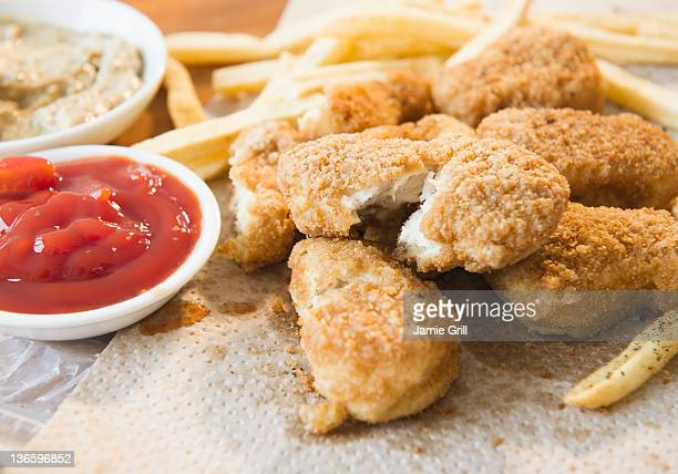close up of fried chicken fingers - breaded stock photos and pictures
