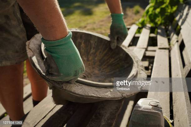 close up of future wash bowl in a mold placed on wooden bench - concentration camp stock pictures, royalty-free photos & images