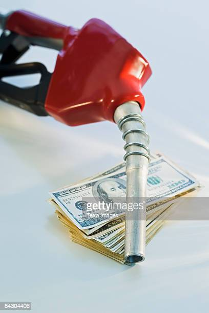 Close up of gas pump and money