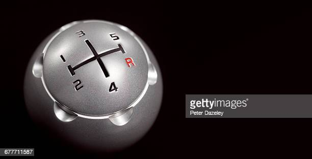 Close up of gear stick against black background