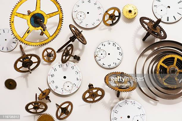 Close up of gears and clock parts on white background