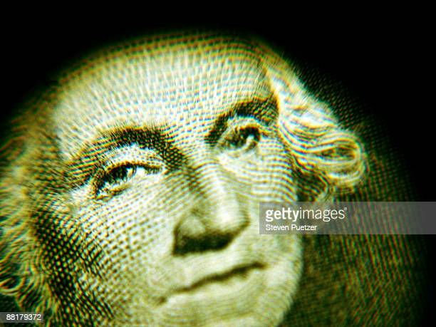 Close up of George Washington's face on a dollar bill