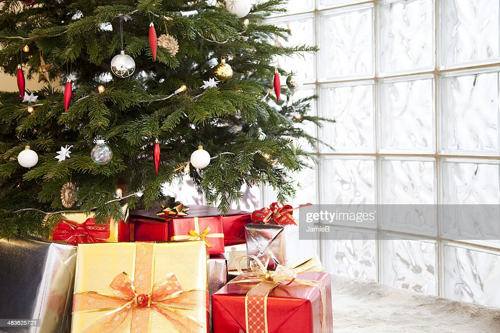Close Up Of Gifts Under A Christmas Tree Stock Photo