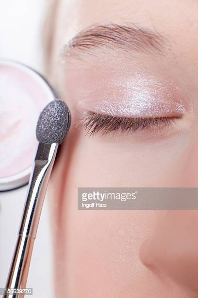 Close up of girl applying makeup