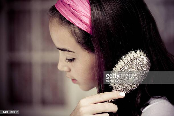close up of girl brushing her hair - sasha gray stock photos and pictures