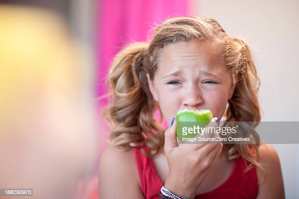 Close up of girl eating apple