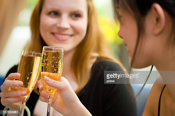 close up of girl friends doing champagne toast