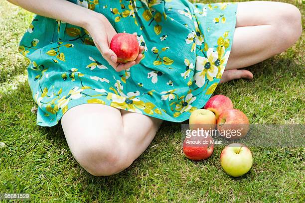 close up of girl holding apple.