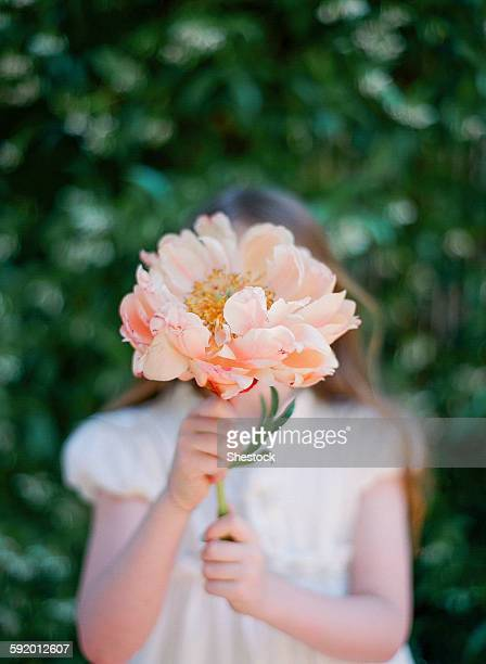 Close up of girl holding bouquet of flowers