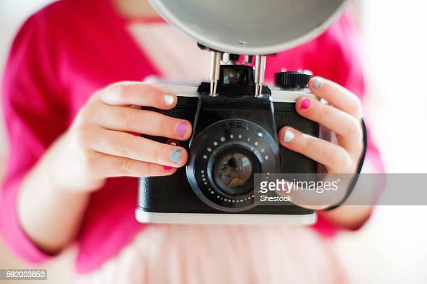 close up of girl holding camera - girls flashing camera stock pictures, royalty-free photos & images