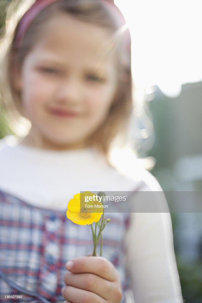 Close up of girl holding flower : Stock Photo