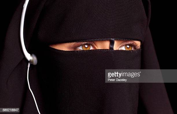 Close up of girl in burka with headphones