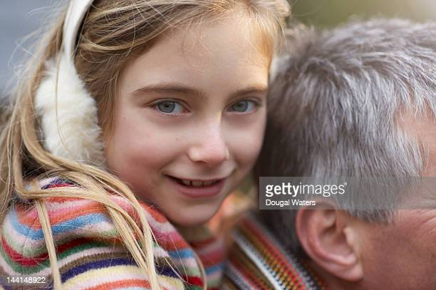 Close up of girl on fathers shoulders.