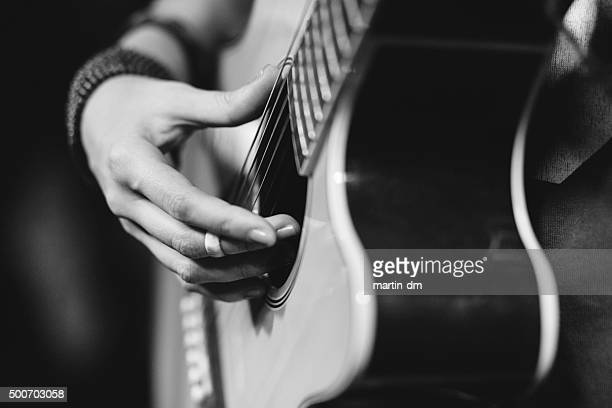 close up of girl playing a guitar - acoustic guitar stock pictures, royalty-free photos & images
