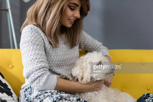 Close up of girl sitting and embracing her dog