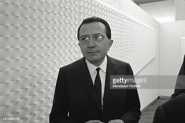 Close up of Giulio Andreotti visiting the art exhibition at the Biennale di Venezia Behind him the works of Enrico Castellani Venice 1966