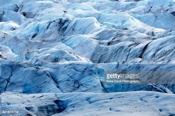 close up of glacier texture at svinafellsjoekull glacier iceland - skaftafell national park stock photos and pictures