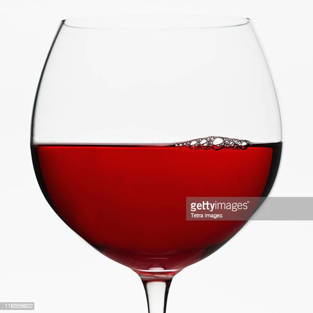 close up of glass of red wine on white background - red wine stock pictures, royalty-free photos & images